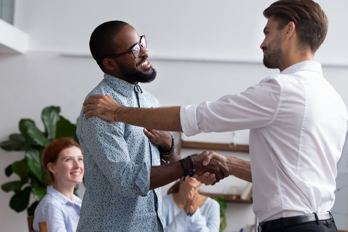 Diverse employees shaking hands for meeting-1