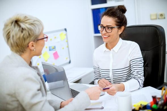 Employees talking in interview-1