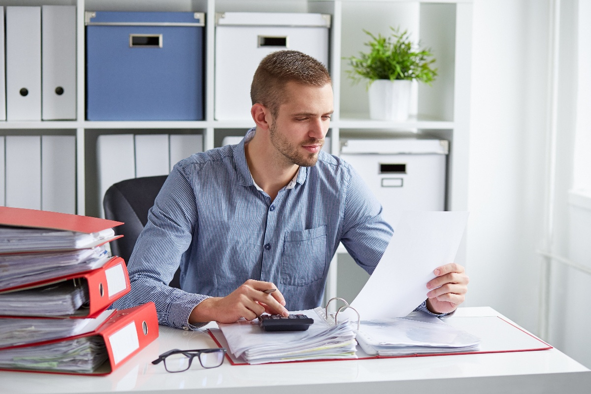 Man looking at paper in office-1