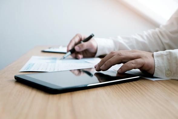 Man using ipad conducting audit