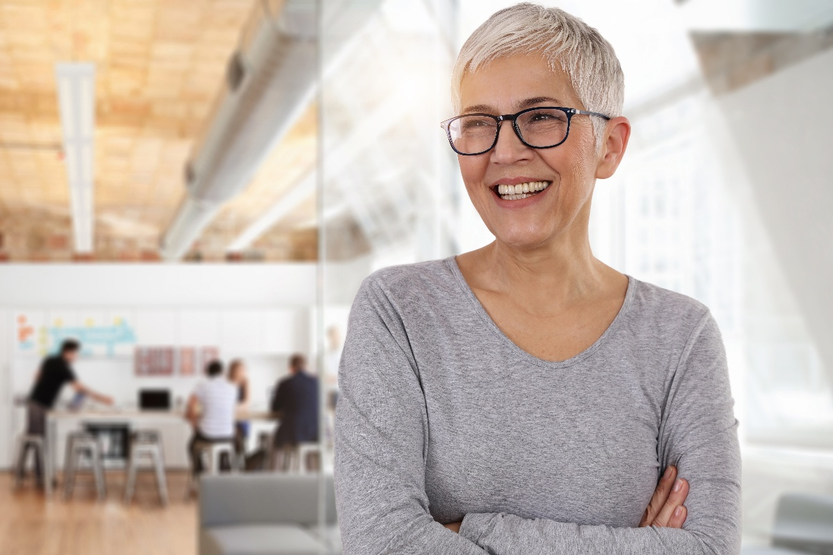 Smiling businesswoman in an office-1