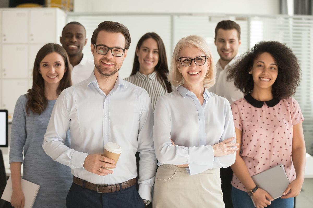 Smiling professionals in workplace for group portrait-1
