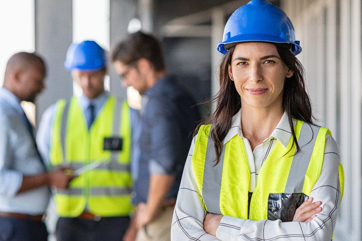Woman construction worker smiling at camera
