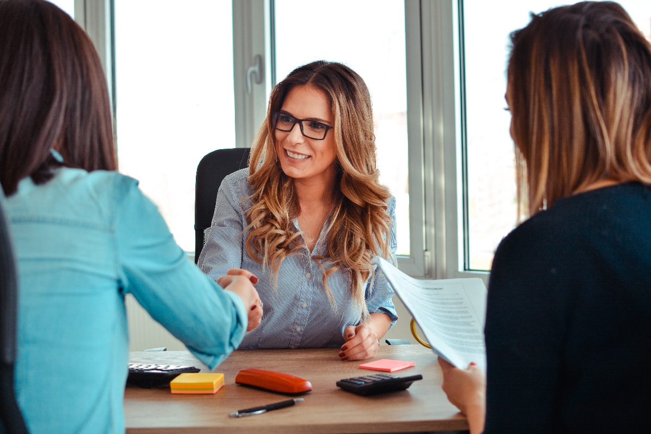 Women shaking hands in office-1
