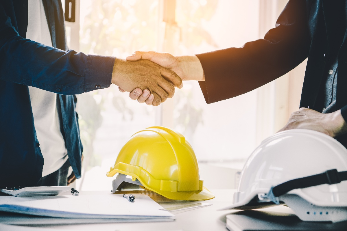 construction employees shaking hands-1